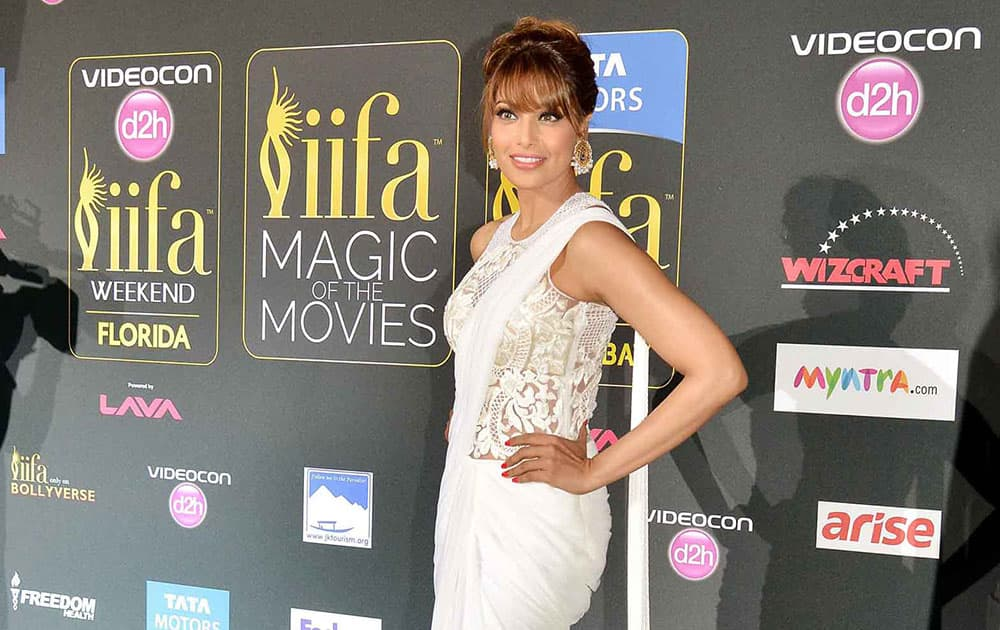 Actress Bipasha Basu poses for photographers as she walks the green carpet for 15th annual International Indian Film Awards in Tampa, Fla. DNA