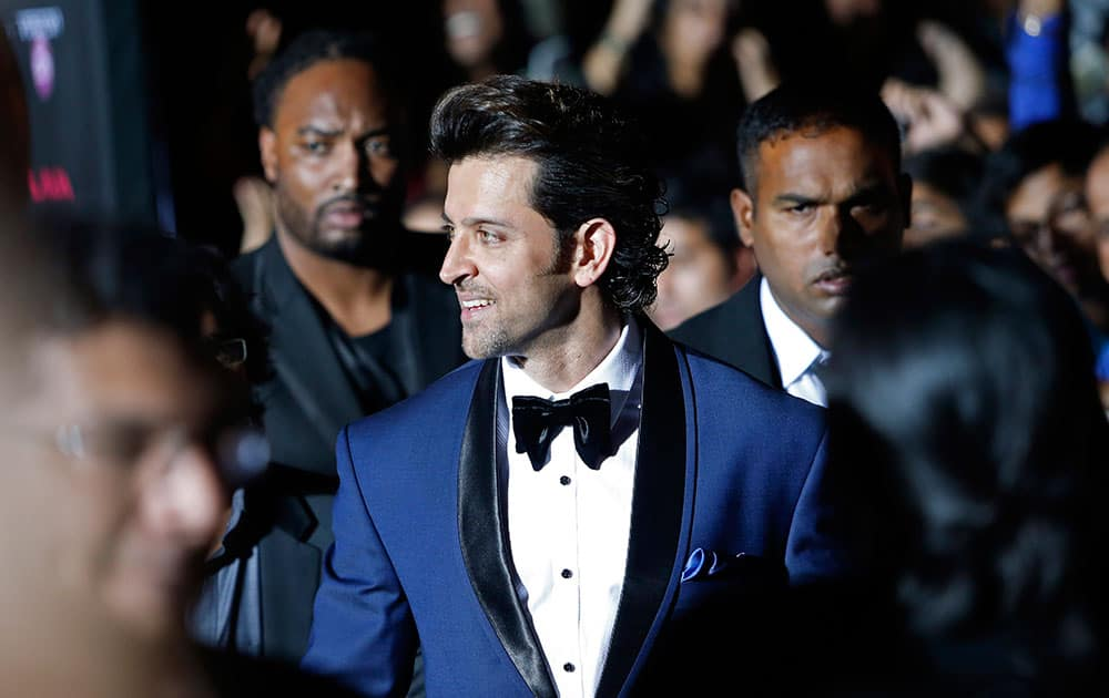 Hrithik Roshan walks the green carpet as he arrives for the 15th annual International Indian Film Awards in Tampa, Fla.