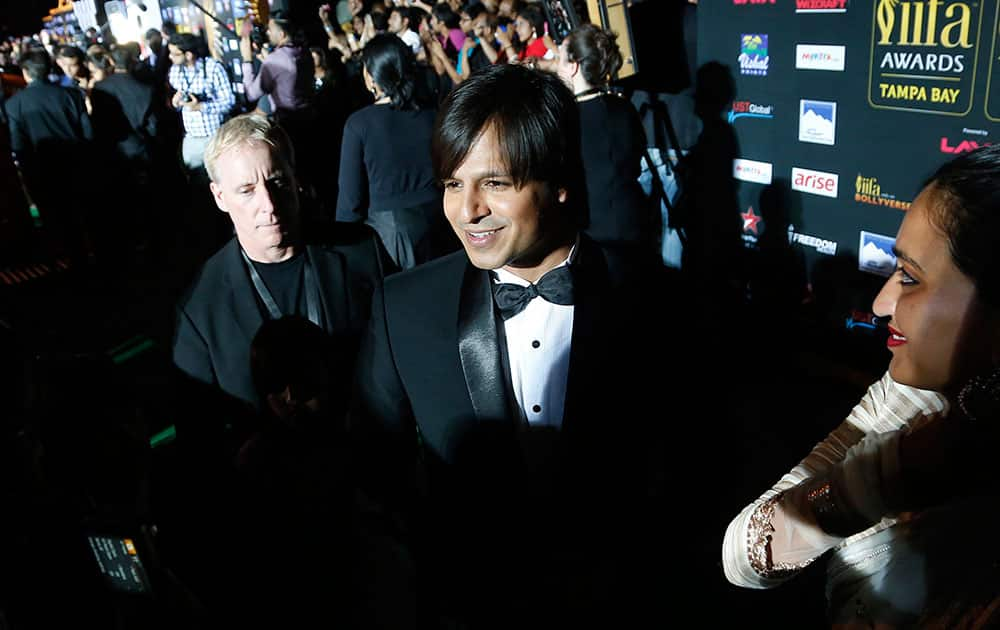 Vivek Oberoi walks the green carpet as he arrives for the 15th annual International Indian Film Awards on Saturday, April 26, 2014, in Tampa, Fla.