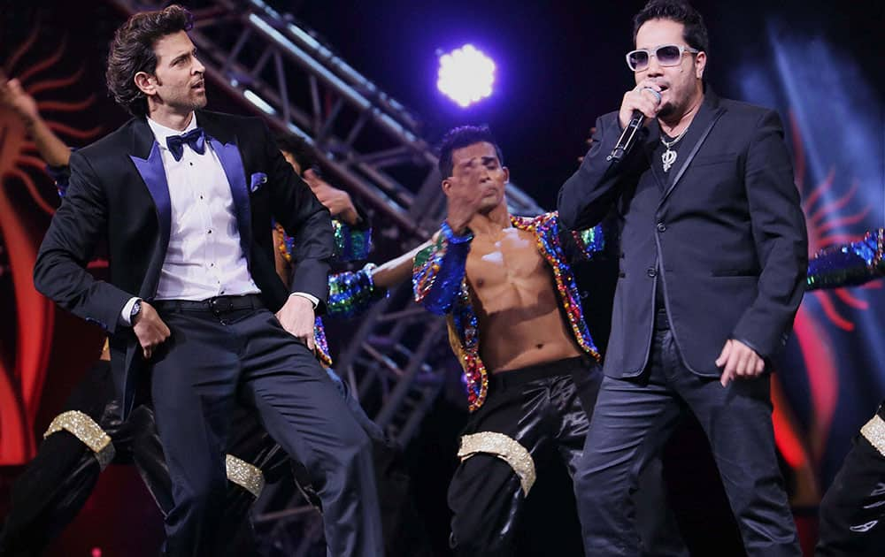 Bollywood actor Hrithik Roshan and singer Mika Singh performing during the IIFA Technical Awards in Tampa, Florida.