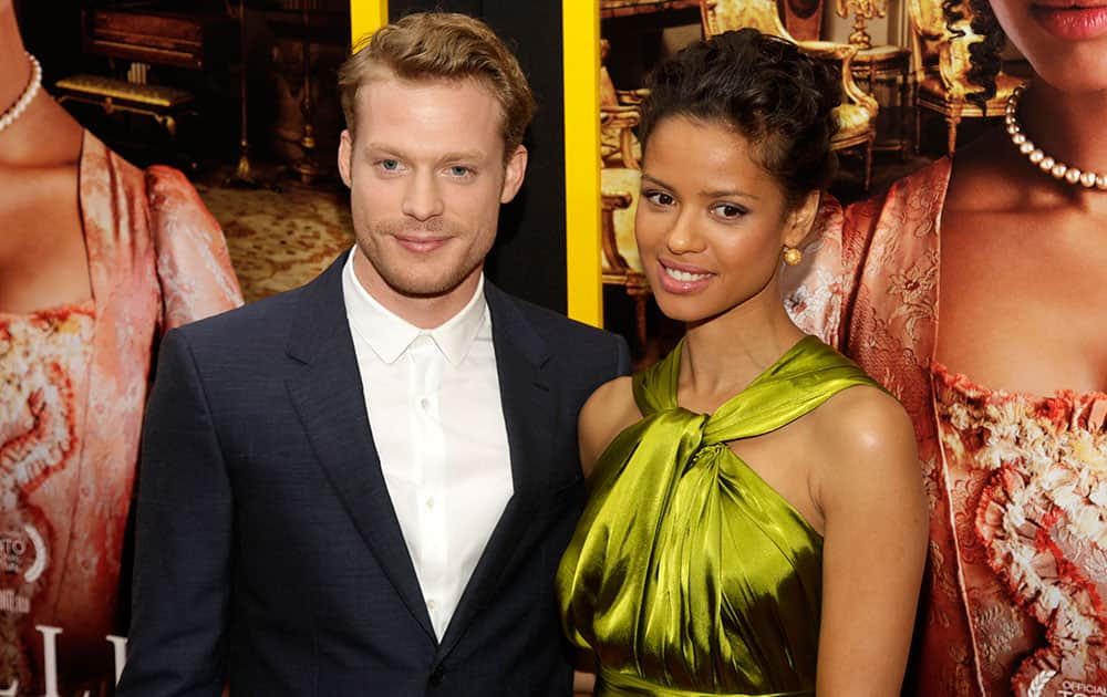 Actor Sam Reid, left, and actress Gugu Mbatha-Raw, right, attend the New York premiere of `Belle`in New York.