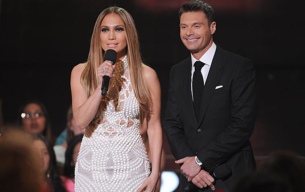 Jennifer Lopez left, and Ryan Seacrest present the award for artist of the year at the iHeartRadio Music Awards at the Shrine Auditorium in Los Angeles.