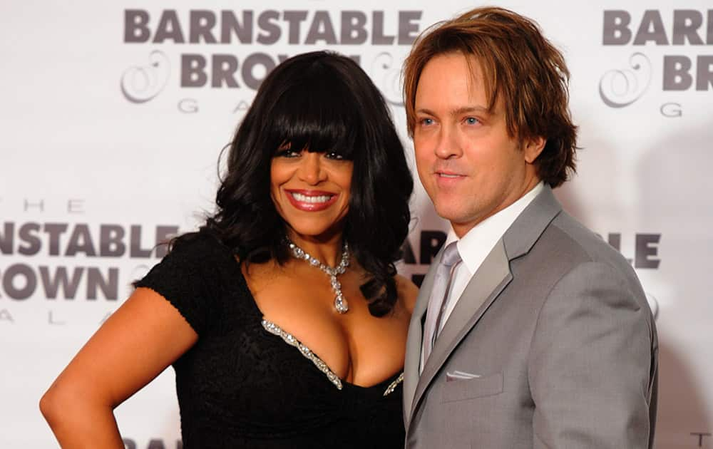 Larry Birkhead and Stacy Francis arrive at the Barnstable Brown Derby gala, in Louisville, Ky.