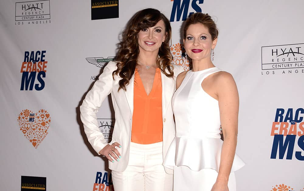 Karina Smirnoff and Candace Cameron-Bure arrive at the 21st Annual Race to Erase MS Gala at the Hyatt Regency Century Plaza Hotel, in Los Angeles.