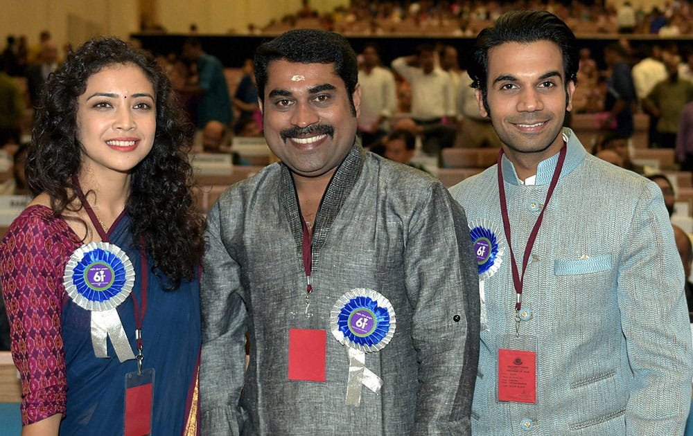 Best lead actress award winner Geetanjali Thapa with Best Actor (Shared) Suraj Venjaramoodu(C) and Raj Kumar poses for a group photo at the 61st National Film Awards 2013 function in New Delhi.