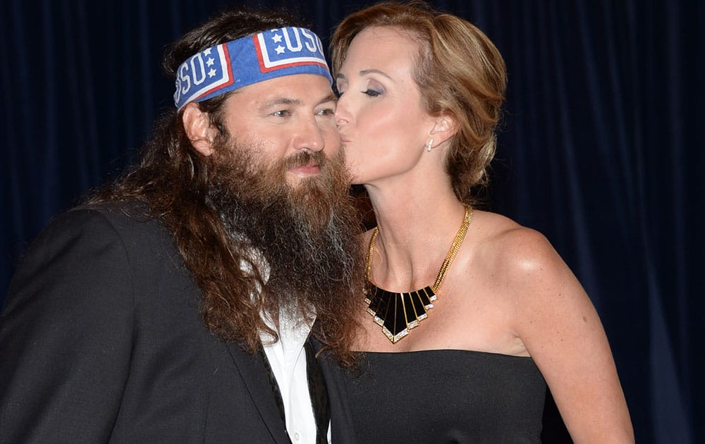 Willie Robertson, left, and Korie Robertson arrive at the White House Correspondents' Association Dinner at the Washington Hilton Hotel, in Washington.