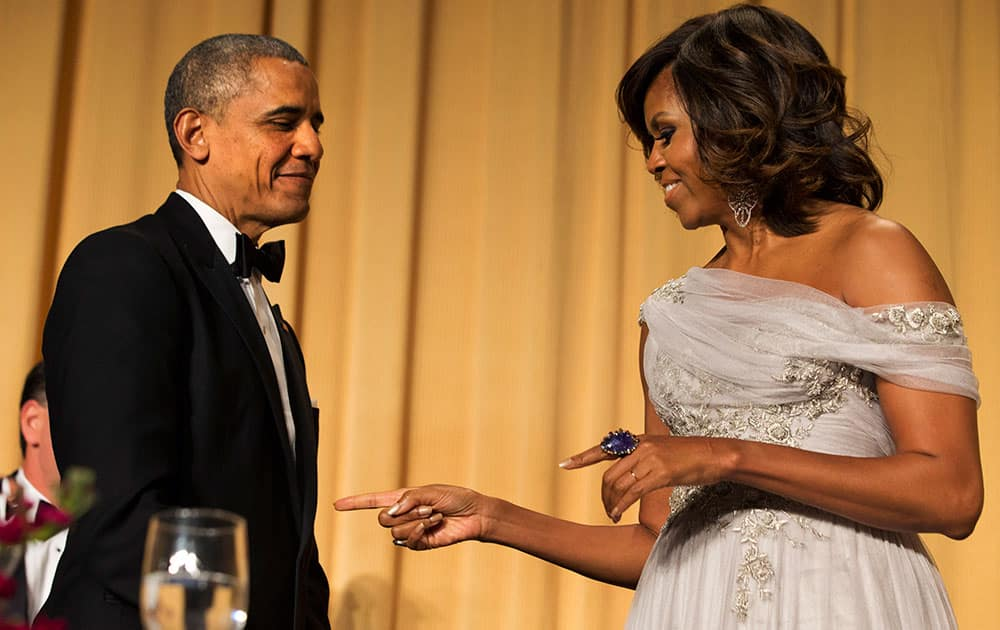 First lady Michelle Obama, left, jokes with President Barack Obama, during the White House Correspondents' Association (WHCA) Dinner at the Washington Hilton Hotel.