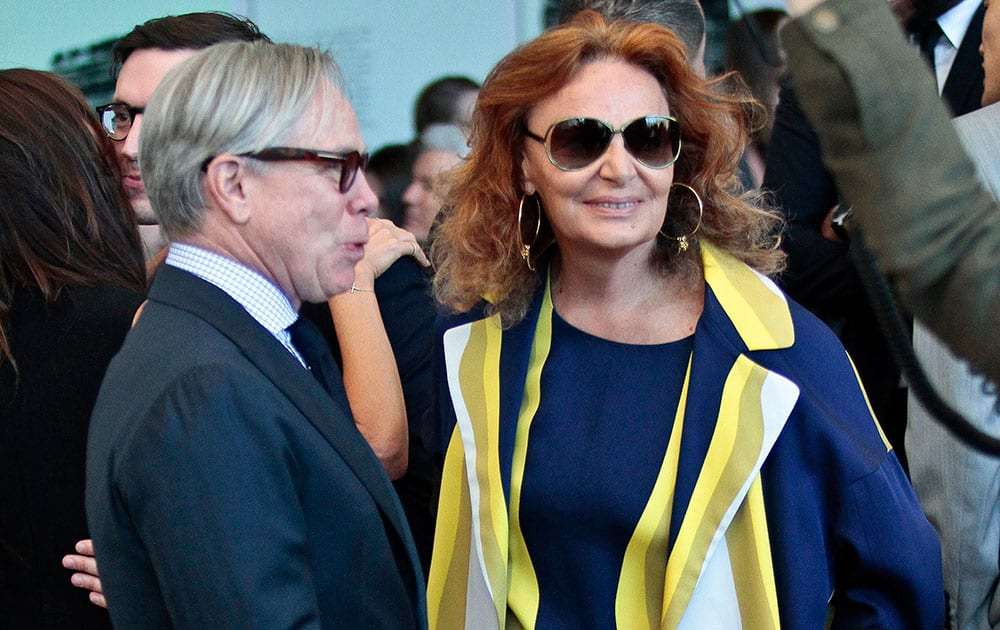 Fashion designers Tommy Hilfiger, left, and Diane von Furstenberg appear at a dedication ceremony for the Anna Wintour Costume Center, at the Metropolitan Museum of Art in New York.