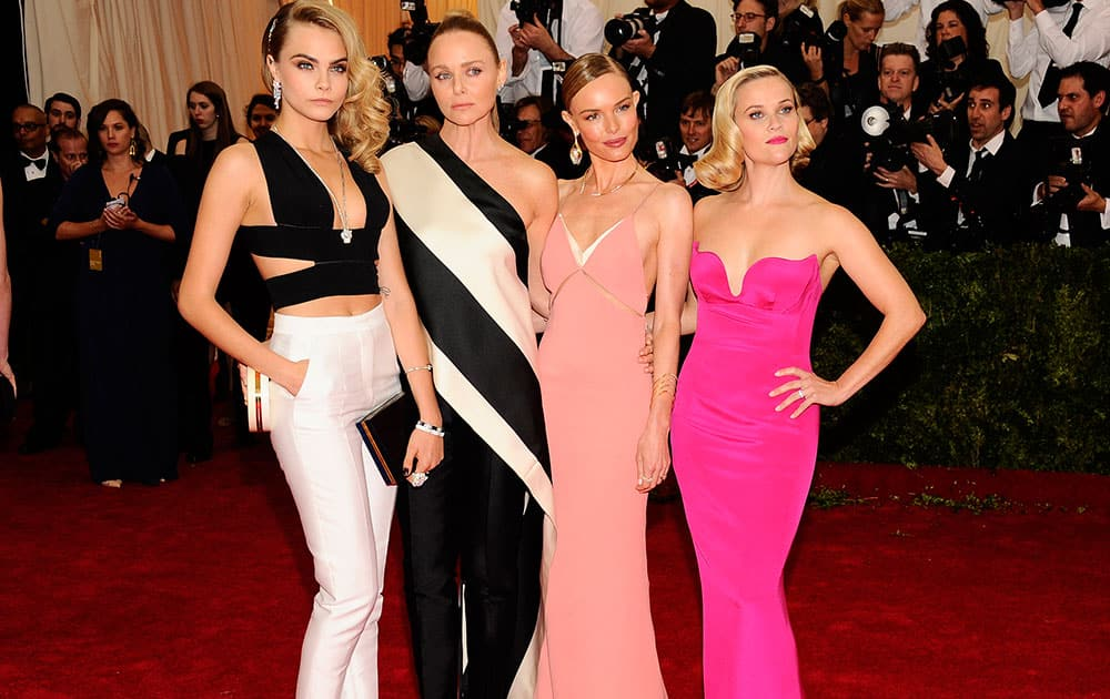 Cara Delevingne, from left, Stella McCartney, Kate Bosworth, and Reese Witherspoon attend The Metropolitan Museum of Art's Costume Institute benefit gala celebrating `Charles James: Beyond Fashion`in New York.