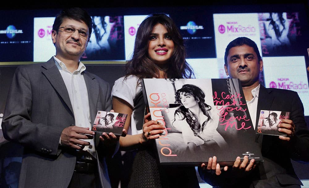 Bollywood actress Priyanka Chopra with Viral Oza, Marketing Director, Nokia India during the launch of her new music video in Mumbai.