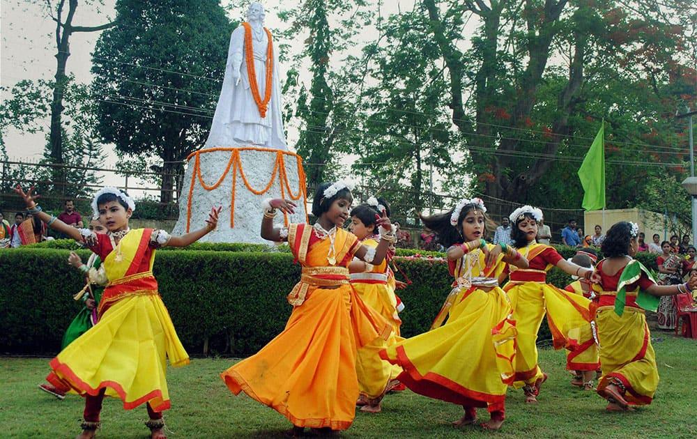 School children celebrate Rabindranath Tagore's 153rd birth anniversary celebrations in Agartala.