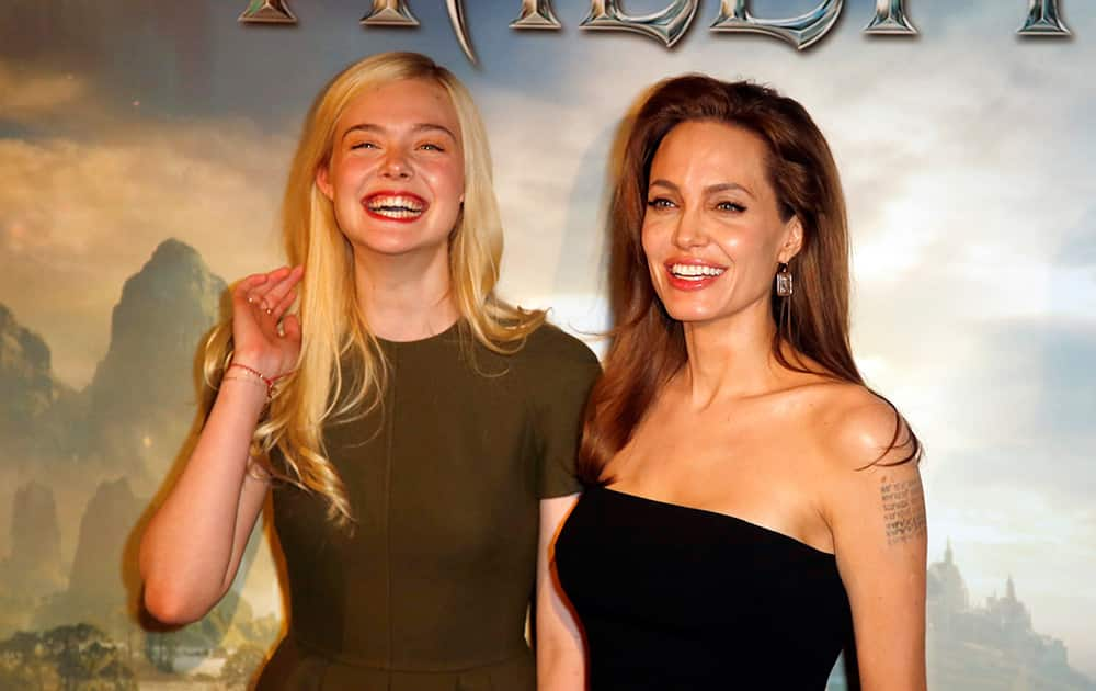 Actresses Angelina Jolie and Elle Fanning pose during a photocall for the film 'Maleficent' (Malefique) in Paris.