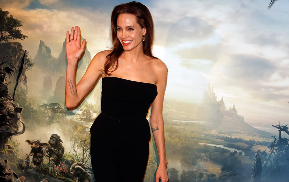 Actress Angelina Jolie poses during a photocall for the film 'Maleficent' (Malefique) in Paris.