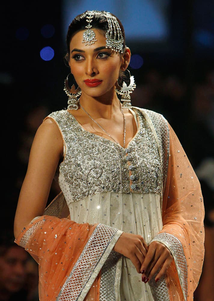 A model presents creation by designer Zainb Chottani during a Bridal Couture Fashion show Karachi, Pakistan.