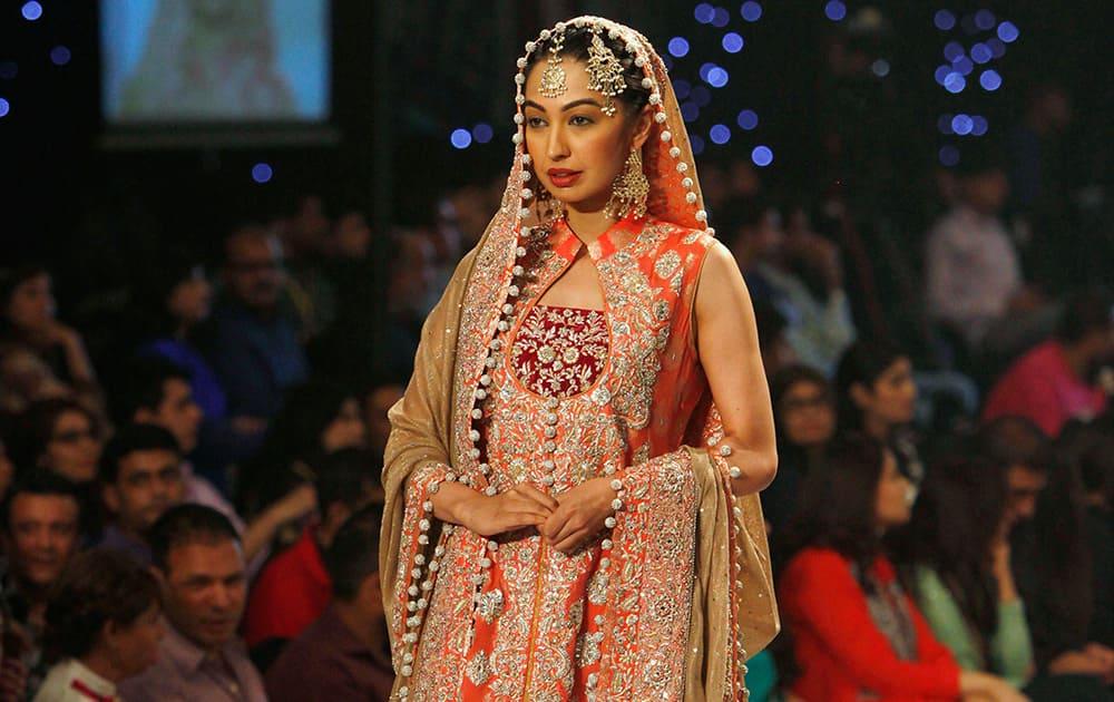 A model presents creation by designer Zainb Chottani during a Bridal Couture Fashion show in Karachi, Pakistan.