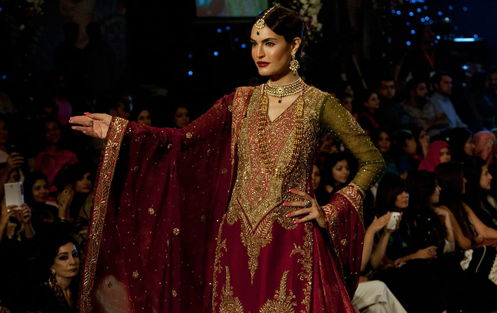 A model presents a creation by designer Zaheer Abbas on the second day of Bridal Couture Week in Karachi, Pakistan.