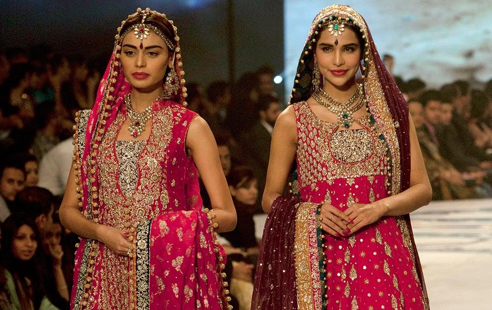Models present creations by designer Zainb Chottani during a Bridal Couture Fashion show in Karachi, Pakistan.