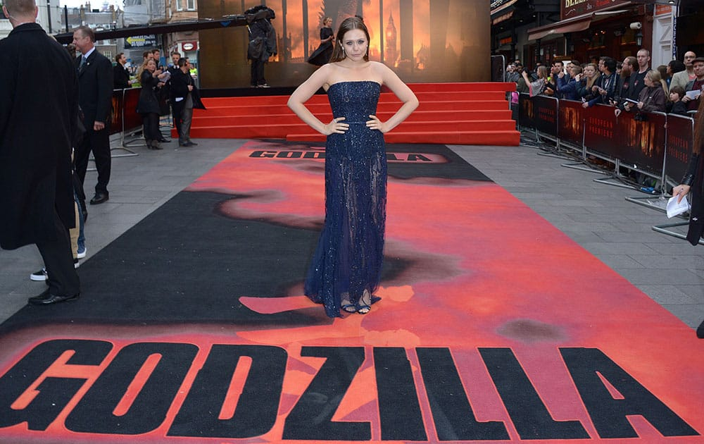 Actress Elizabeth Olsen poses for photographers on the red carpet for the UK premiere of Godzilla in London.
