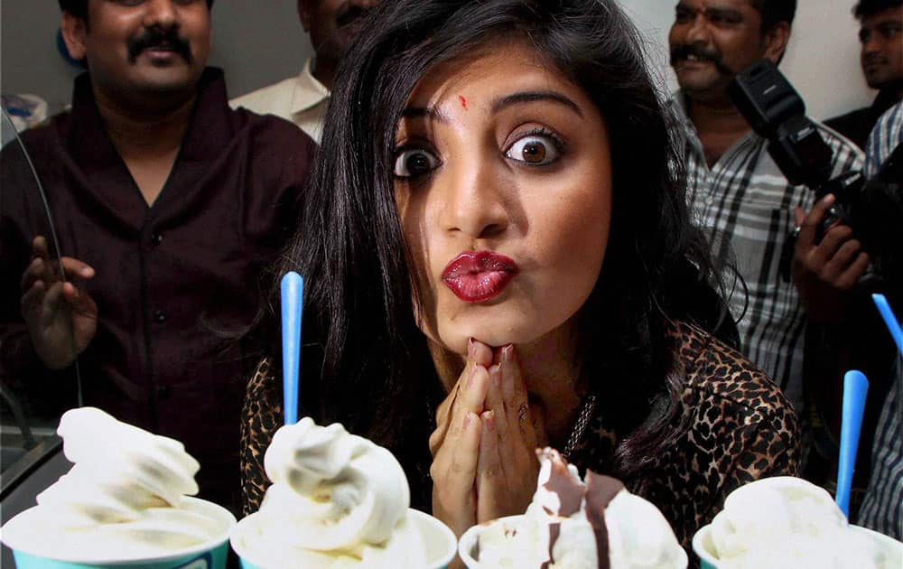 Actress Poonam Kaur tastes gelato-Italian-low fat yoghurt, at the launch of Italy's famous chain of Ci-Gusta at Banjara Hills in Hyderabad.