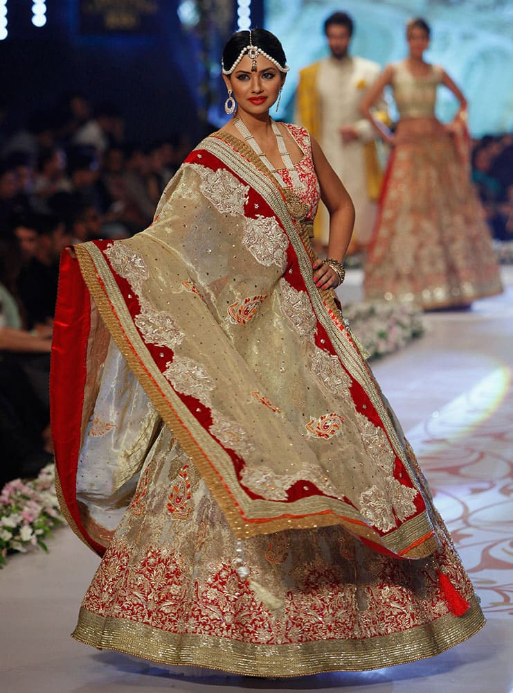 A model presents a creation by designer Deepak Perwani on the third day of the Bridal Couture Week in Karachi.