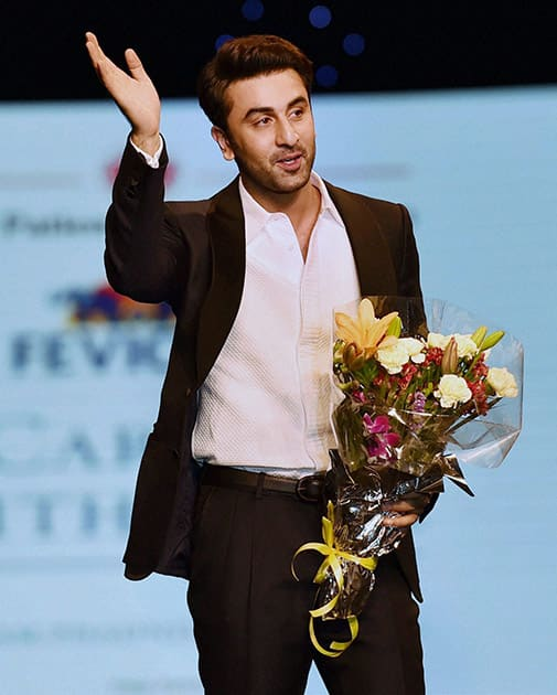 Ranbir Kapoor walks the ramp during a fashion show to support Cancer patients in Mumbai .