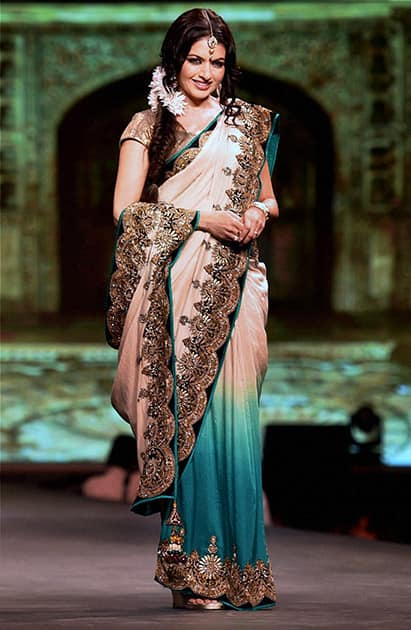 Bhagyashree Patwardhan walks the ramp for designer Vikram Phadnis during a fashion show to support Cancer patients in Mumbai.