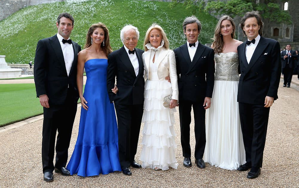 Ralph Lauren, 3rd left, Ricky Anne Loew-Beer, 4th left, and unidentified members of the Lauren family arrive for a dinner hosted by the Duke of Cambridge to celebrate the work of The Royal Marsden, at Windsor Castle, England.