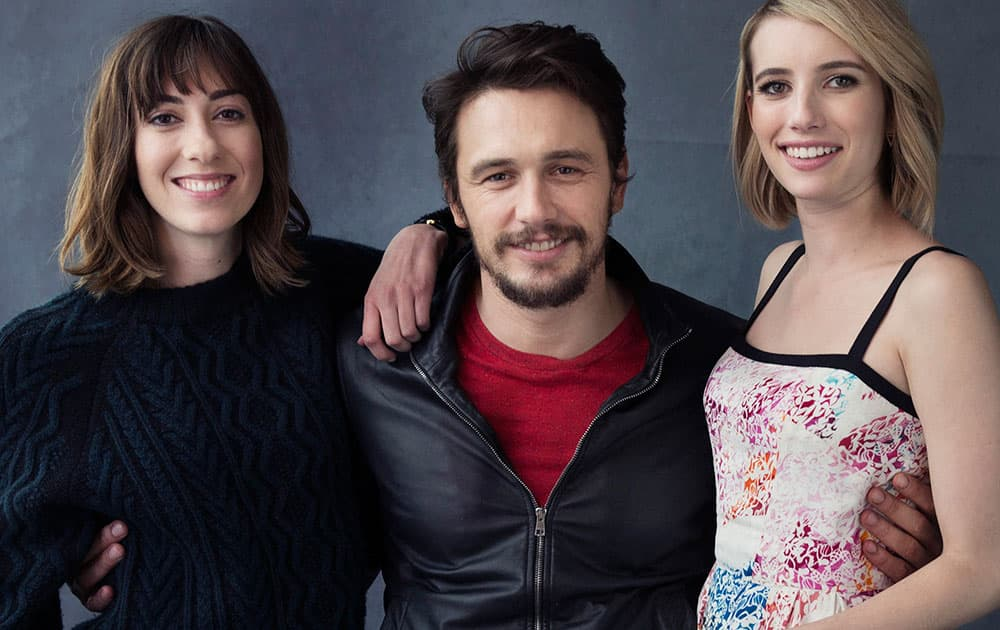 From left, writer-director Gia Coppola, actor, James Franco, and actress, Emma Roberts pose for a portrait in promotion of their film `Palo Alto,` in New York.