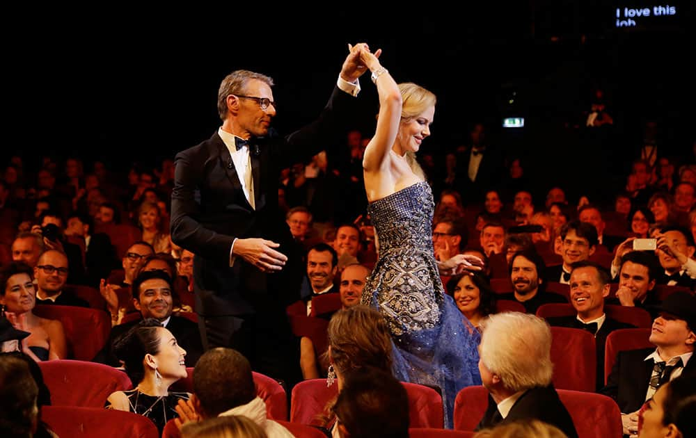 Master of Ceremonies Lambert Wilson, left, and actress Nicole Kidman during the opening ceremony ahead of the screening of Grace Of Monaco at the 67th international film festival, Cannes.