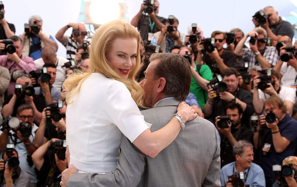 Actress Nicole Kidman, left, and actor Tim Roth pose for photographers during a photo call for the film Grace of Monaco at the 67th international film festival, Cannes.