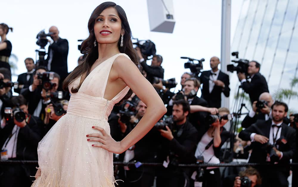 Actress Freida Pinto poses for photographers as she arrives for the screening of Saint-Laurent at the 67th international film festival, Cannes, southern France.