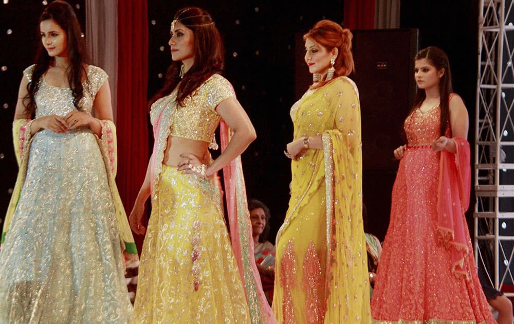 Models during a fashion show, `The Festival of Hope` for helping the Indian Cancer Society in Gurgaon.