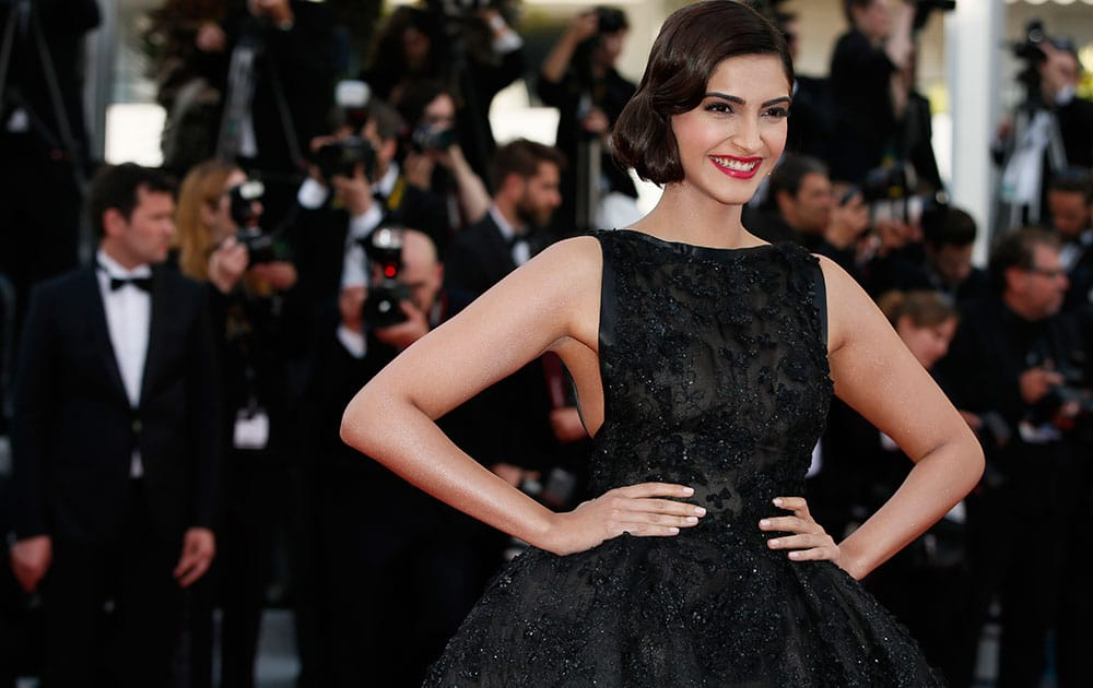 Actress Sonam Kapoor poses for photographers as she arrives for the screening of The Homesman at the 67th international film festival, Cannes, southern France.