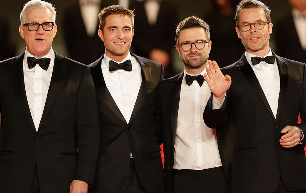 From left, producer David Linde, actor Robert Pattinson, director David Michod, and actor Guy Pearce pose for photographers as they arrive for the screening of The Rover at the 67th international film festival, Cannes.