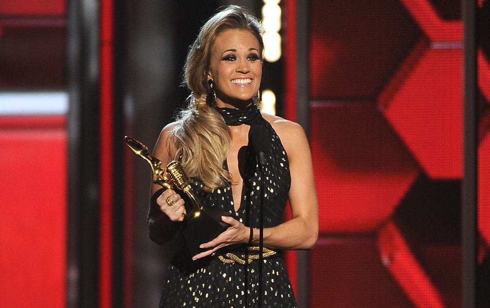 Carrie Underwood accepts the milestone award at the Billboard Music Awards at the MGM Grand Garden Arena.