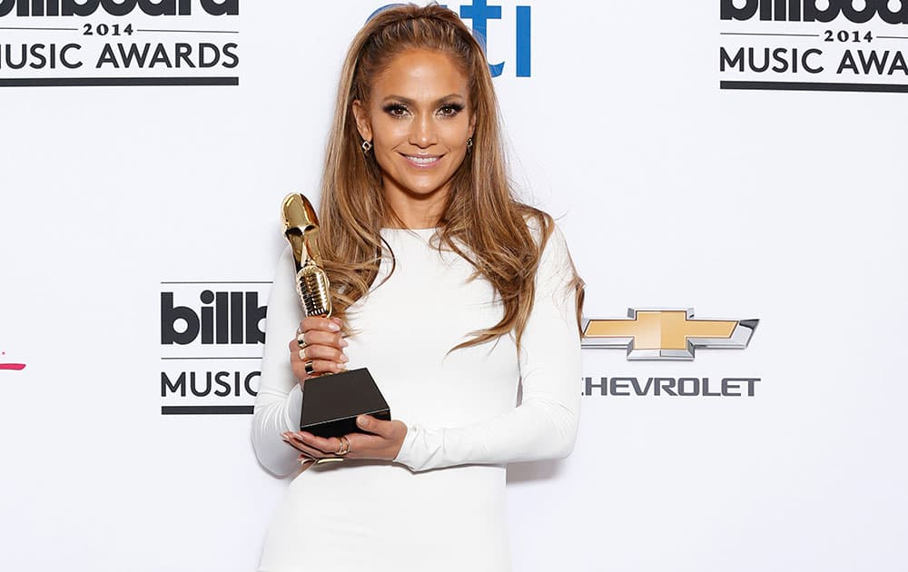 Jennifer Lopez poses in the press room with the icon award at the Billboard Music Awards at the MGM Grand Garden Arena.