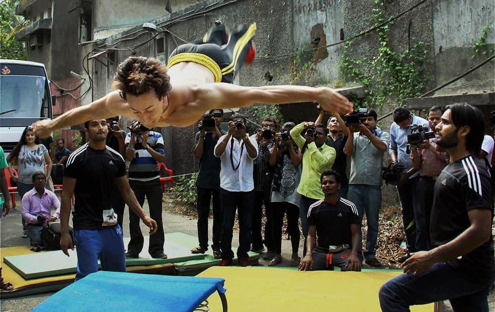 Tiger Shroff performs a parkour stunt to promote his upcoming film Heropanthi in Mumbai.