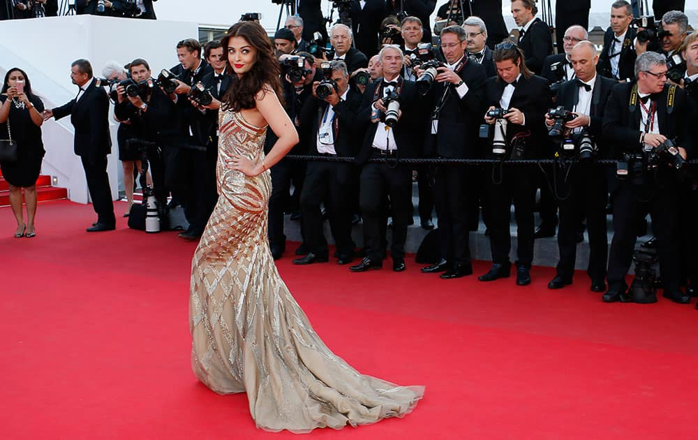 Actress Aishwarya Rai Bachchan poses for photographers as she arrives for the screening of Two Days, One Night (Deux jours, une nuit) at the 67th international film festival, Cannes, southern France.