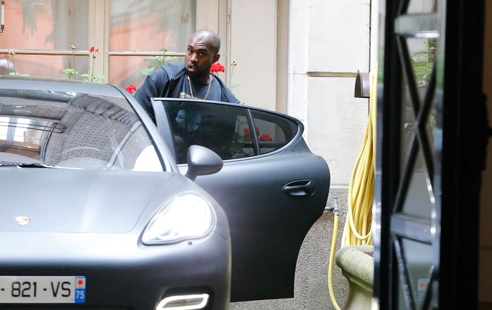 U.S rap singer Kanye West enters his car as he leaves a luxury shop in Paris. The gates of the Chateau de Versailles, once the digs of Louis XIV, will be thrown open to Kim Kardashian, Kanye West and their guests for a private evening this week ahead of their marriage.