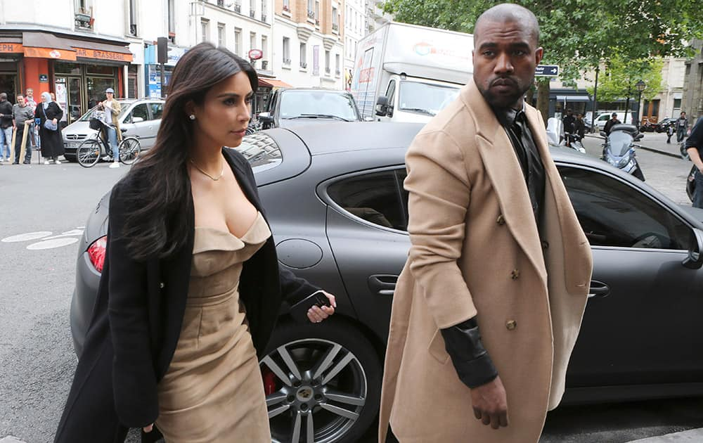 Kim Kardashian and U.S rap singer Kanye West arrive at a luxury shop in Paris. The gates of the Chateau de Versailles, once the digs of Louis XIV, will be thrown open to Kim Kardashian, Kanye West and their guests for a private evening this week ahead of their marriage.