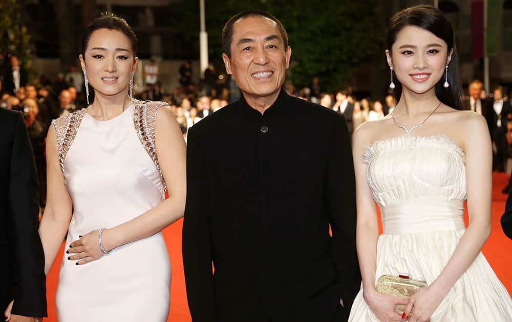 Actress Gong Li, director Zhang Yimou and actress Zhang Huiwen arrive for the screening of Coming Home (Gu Lai) at the 67th international film festival, Cannes, southern France.