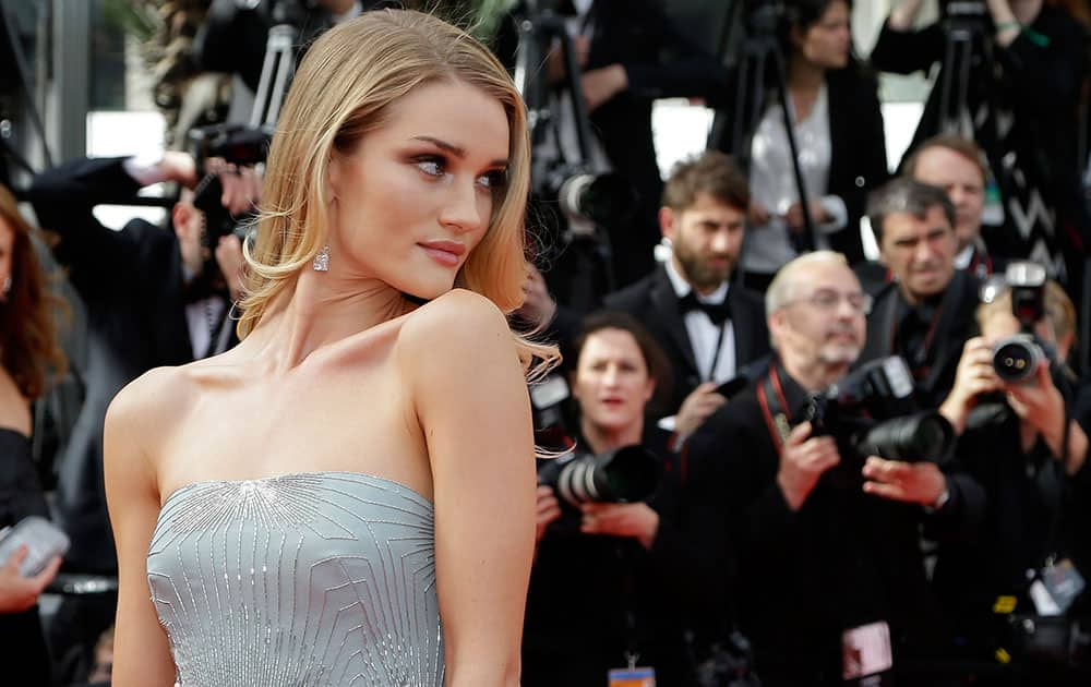 Model Rosie Huntington-Whiteley poses for photographers as she arrives for the screening of The Search at the 67th international film festival, Cannes, southern France