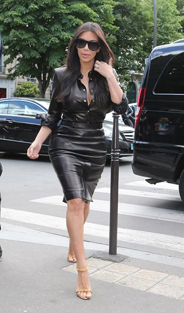 Kim Kardashian arrives at a restaurant in Paris. The gates of the Chateau de Versailles, once the digs of Louis XIV, will be thrown open to Kim Kardashian, Kanye West and their guests for a private evening this week ahead of their marriage.
