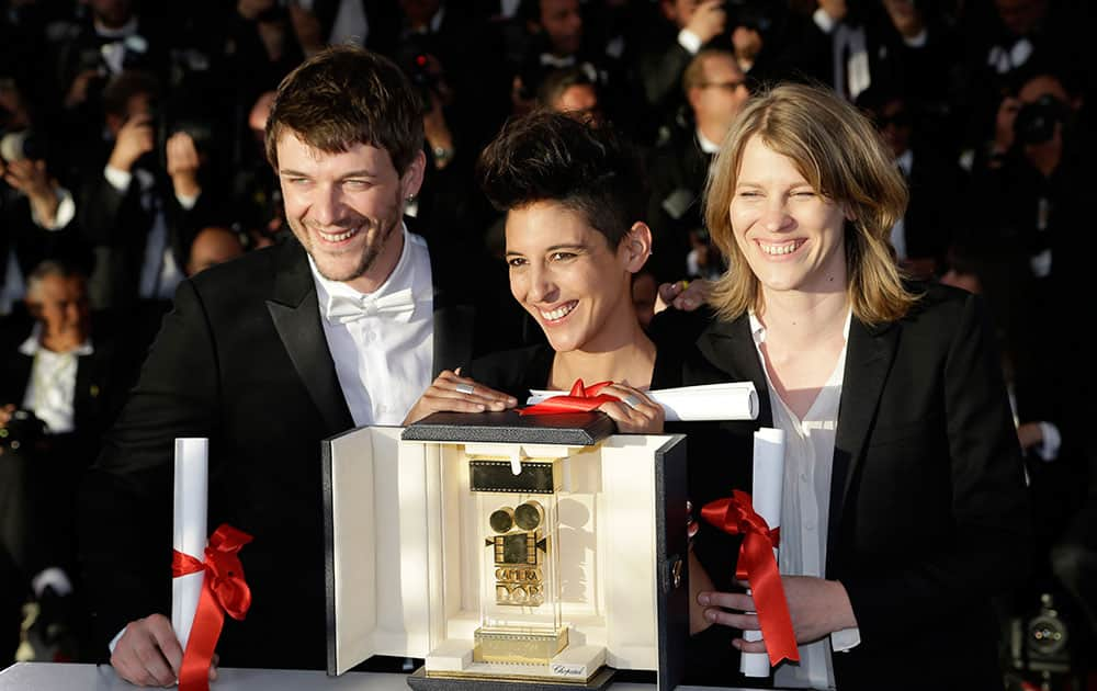 From left, Samuel Theis, Marie Amachoukeli, and Claire Burger pose after winning the Camera d'Or award for the film during a photo call following the awards ceremony at the 67th international film festival, Cannes.