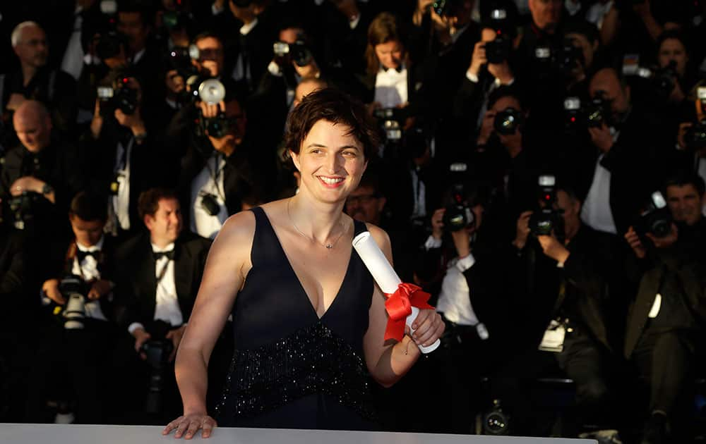 Director Alice Rohrwacher poses after winning the Grand Prix award for the film The Wonders (Le meraviglie) during a photo call following the awards ceremony at the 67th international film festival, Cannes.