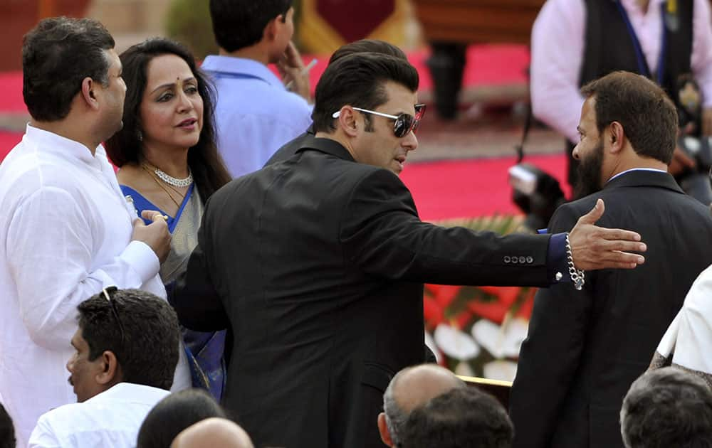 Actress and BJP politician Hema Malini and Salman Khan at the swearing-in ceremony of Narendra Modi at Rashtrapati Bhawan in New Delhi. dna