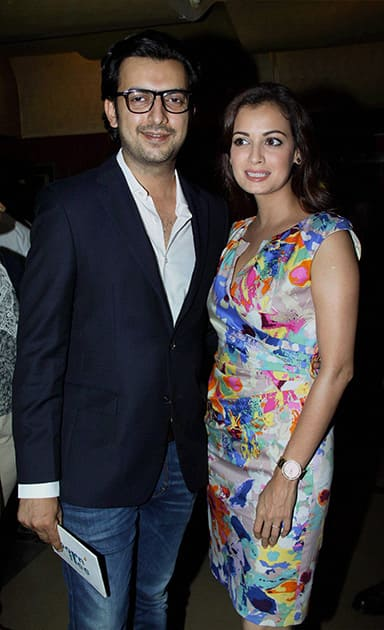 Dia Mirza (R) poses with partner Sahil Sangha during the trailer launch of the forthcoming Hindi film 'Bobby Jasoos' in Mumbai.