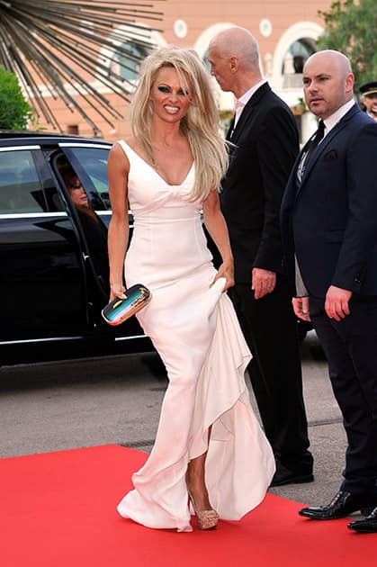 Canadian-American actress Pamela Anderson poses as she arrives for the World Music Awards in Monaco.