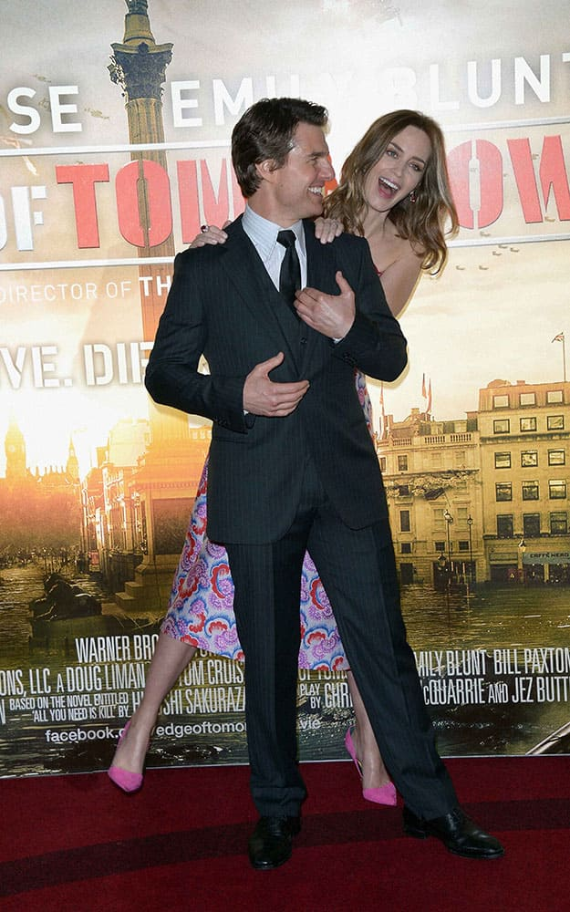 British actress Emily Blunt, background and US actor Tom Cruise pose for photographers at the Edge Of Tomorrow World Premiere at BFI IMAX in London.