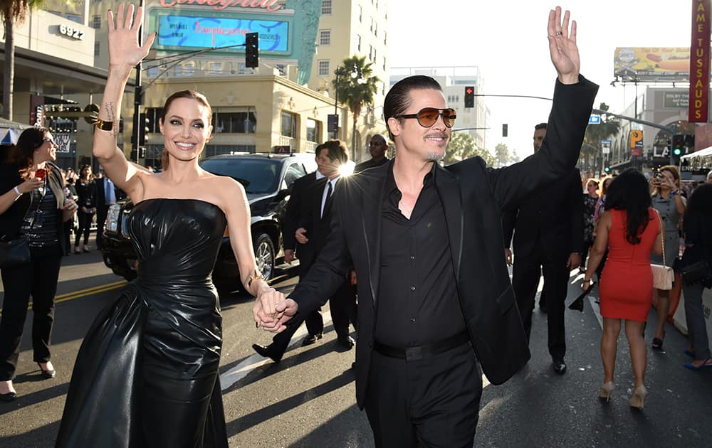 Angelina Jolie, left, and Brad Pitt arrive at the world premiere of `Maleficent` at the El Capitan Theatre in Los Angeles.
